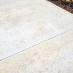 stamped concrete square outside rock